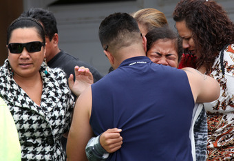OCEANSIDE, CA - MAY 2:  Friends and family members of Junior Seau, who was found dead, console each other outside the former linebacker's beach home May 2, 2012 in Oceanside, California. Seau, who played for various NFL teams including the San Diego Charg