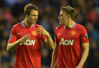 WIGAN, ENGLAND - APRIL 11: Jonny Evans of Manchester United speaks to team mate Phil Jones during the Barclays Premier League match between Wigan Athletic and Manchester United at the DW Stadium on April 11, 2012 in Wigan, England.  (Photo by Michael Rega