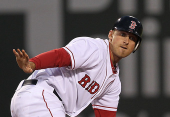 BOSTON, MA - MAY 2:  Will Middlebrooks #64 of the Boston Red Sox calls for time after stealing a base against the Oakland Athletics at Fenway Park May 2, 2012  in Boston, Massachusetts. (Photo by Jim Rogash/Getty Images)