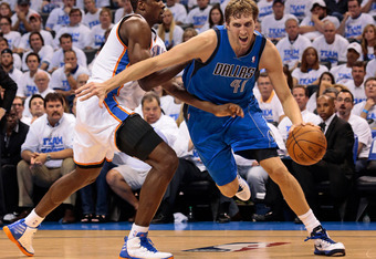 OKLAHOMA CITY, OK - APRIL 30:  Dirk Nowitzki #41 of the Dallas Mavericks drives on Serge Ibaka #9 of the Oklahoma City Thunder in Game Two of the Western Conference Quarterfinals in the 2012 NBA Playoffs on April 30, 2012 at the Chesapeake Energy Arena in