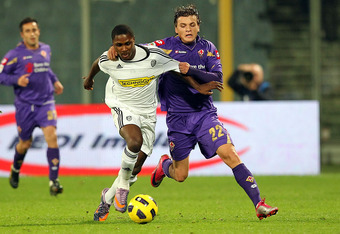 FLORENCE, ITALY - NOVEMBER 13: Adem Ljajic of ACF Fiorentina (R) battles for the ball with Odion Jude Ighalo of AC Cesena during the Serie A match between Fiorentina and Cesena at Stadio Artemio Franchi on November 13, 2010 in Florence, Italy.  (Photo by