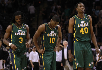 SAN ANTONIO, TX - MAY 02: (L-R) DeMarre Carroll #3, Alec Burks #10 and Jeremy Evans #40 of the Utah Jazz walk off the court after a loss against the San Antonio Spurs in Game Two of the Western Conference Quarterfinals of the 2012 NBA Playoffs at AT&T Cen