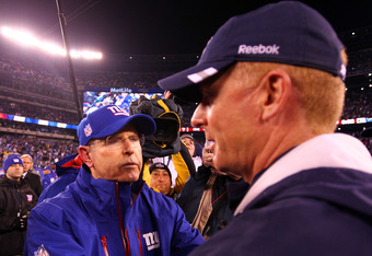 EAST RUTHERFORD, NJ - JANUARY 01:  Head coach Tom Coughlin greets Head coach Jason Garrett of the Dallas Cowboys after their game at MetLife Stadium on January 1, 2012 in East Rutherford, New Jersey.  (Photo by Al Bello/Getty Images)