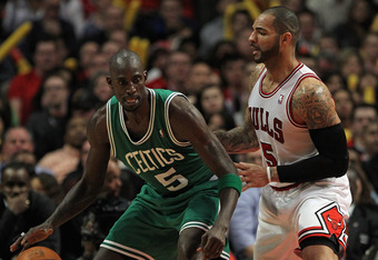 CHICAGO, IL - FEBRUARY 16:  Kevin Garnett #5 of the Boston Celtics moves against Carlos Boozer #5 of the Chicago Bulls at the United Center on February 16, 2012 in Chicago, Illinois.The Bulls defeated the Celtics 89-80. NOTE TO USER: User expressly acknow