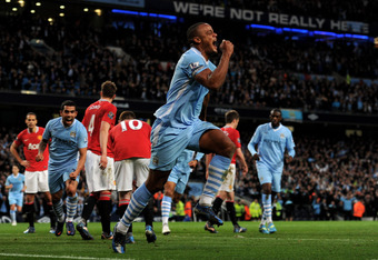 MANCHESTER, ENGLAND - APRIL 30:  Vincent Kompany of Manchester City celebrates scoring the opening goal during the Barclays Premier League match between Manchester City and Manchester United at the Etihad Stadium on April 30, 2012 in Manchester, England.