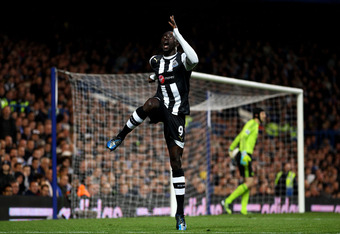 LONDON, ENGLAND - MAY 02:  Papiss Cisse of Newcastle celebrates after scoring the opening goal during the Barclays Premier League match between Chelsea and Newcastle United at Stamford Bridge on May 2, 2012 in London, England.  (Photo by Julian Finney/Get