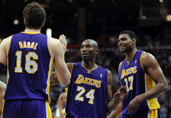 LOS ANGELES, CA - APRIL 04:  Kobe Bryant #24 of the Los Angeles Lakers celebrates with Andrew Bynum #17 and Pau Gasol #16 during the game against the Los Angeles Clippers at Staples Center on April 4, 2012 in Los Angeles, California.  NOTE TO USER: User e
