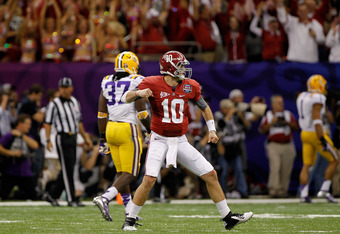 NEW ORLEANS, LA - JANUARY 09:  AJ McCarron #10 of the Alabama Crimson Tide celebrates a 34-yard touchdown run by Trent Richardson #3 in the fourth quarter against the Louisiana State University Tigers during the 2012 Allstate BCS National Championship Gam