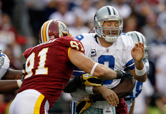 LANDOVER, MD - NOVEMBER 20:  Ryan Kerrigan #91 of the Washington Redskins hits  Tony Romo #9 of the Dallas Cowboys after Romo threw a pass during the second half at FedExField on November 20, 2011 in Landover, Maryland.  (Photo by Rob Carr/Getty Images)
