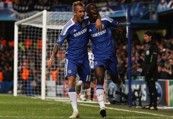 LONDON, ENGLAND - DECEMBER 06:  Ramires of Chelsea celebrates with Raul Meireles (L) as he scores their second goal during the UEFA Champions League Group E match between Chelsea FC and Valencia CF at Stamford Bridge on December 6, 2011 in London, England