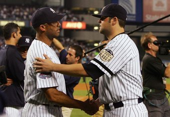 NEW YORK - SEPTEMBER 21: Mariano Rivera #42 (L) and Joba Chamberlain #62 of the New York Yankees shake hands after the last regular season game at Yankee Stadium on September 21, 2008 in the Bronx borough of New York City. The Yankees are playing their fi