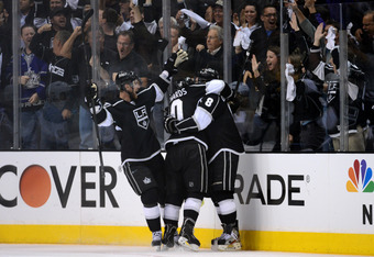 LOS ANGELES, CA - MAY 03:  (R) Drew Doughty #8 of the Los Angeles Kings celebrates his third period goal with teammates Jeff Carter #77 and Mike Richards #10 against the St. Louis Blues in Game Three of the Western Conference Semifinals during the 2012 NH