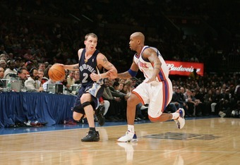 NEW YORK - DECEMBER 1:  Jason Williams #2 of the Memphis Grizzlies moves the ball against Stephon Marbury #3 of the New York Knicks December 1, 2004 at Madison Square Garden in New York, New York.  The Knicks won 90-82.  NOTE TO USER: User expressly ackno