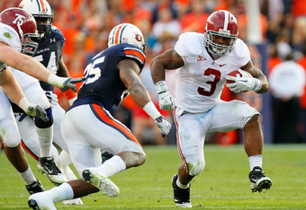 AUBURN, AL - NOVEMBER 26:  Trent Richardson #3 of the Alabama Crimson Tide rushes upfield against the Alabama Crimson Tide at Jordan-Hare Stadium on November 26, 2011 in Auburn, Alabama.  (Photo by Kevin C. Cox/Getty Images)