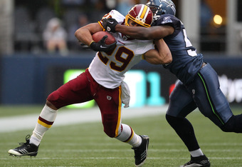 SEATTLE, WA - NOVEMBER 27:  Running back Roy Helu #29 of the Washington Redskins rushes against David Hawthorne #57 of the Seattle Seahawks at CenturyLink Field on November 27, 2011 in Seattle, Washington. The Redskins defeated the Seahawks 23-17. (Photo