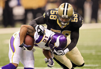 NEW ORLEANS - JANUARY 24:  Scott Shanle #58 of the New Orleans Saints tackles Percy Harvin #12 of the Minnesota Vikings during the NFC Championship Game at the Louisana Superdome on January 24, 2010 in New Orleans, Louisiana.  (Photo by Ronald Martinez/Ge