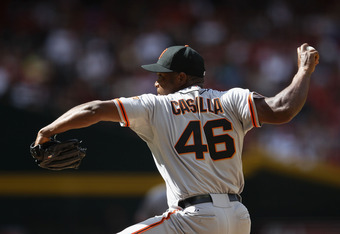 PHOENIX, AZ - APRIL 07:  Relief pitcher Santiago Casilla #46 of the San Francisco Giants pitches against the Arizona Diamondbacks during the MLB game at Chase Field on April 7, 2012 in Phoenix, Arizona. The Diamondbacks defeated the Giants 5-4.  (Photo by