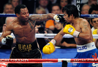 LAS VEGAS, NV - MAY 07:  Shane Mosley (L) throws a left at Manny Pacquiao in the sixth round of their WBO welterweight title fight at the MGM Grand Garden Arena May 7, 2011 in Las Vegas, Nevada. Pacquiao retained his title with a unanimous-decision victor