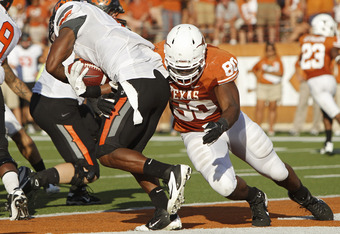 AUSTIN, TX - OCTOBER 15:  Defensive end Alex Okafor #80 of the Texas Longhorns tackles running back Joseph Randle #1 of the Oklahoma State Cowboys in the fourth quarter on October 15, 2011 at Darrell K. Royal-Texas Memorial Stadium in Austin, Texas.  Okla