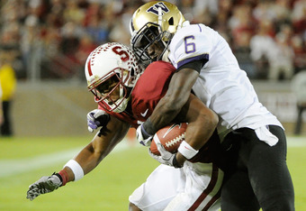 Stanford Cardinal, CA - OCTOBER 22:  Desmond Trufant #6 of Washington Huskies tackles Chris Owusu #81 of the Stanford Cardinal at Stanford Stadium on October 22, 2011 in Stanford, California. Stanford won the game 65-21. (Photo by Thearon W. Henderson/Get