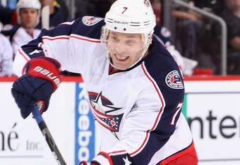 GLENDALE, AZ - APRIL 03:  Jack Johnson #7 of the Columbus Blue Jackets skates with the puck during the NHL game against the Phoenix Coyotes at Jobing.com Arena on April 3, 2012 in Glendale, Arizona. The Coyotes defeated the Blue Jackets 2-0.  (Photo by Ch