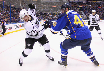 ST. LOUIS, MO - APRIL 30: David Backes #42 of the St. Louis Blues knocks Dustin Brown #23 of the Los Angeles Kings off the puck in Game Two of the Western Conference Semifinals during the 2012 NHL Stanley Cup Playoffs at the Scottrade Center  on April 30,