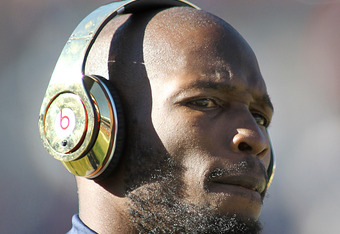DENVER, CO - DECEMBER 18: Chad Ochocinco #85 of the New England Patriots listens to music during pre-game warmups on December 18, 2011 before facing the Denver Broncos at Sports Authority Field at Mile High in Denver, Colorado. (Photo by Marc Piscotty/Get