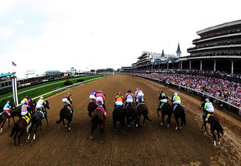 LOUISVILLE, KY - MAY 04:  The field comes out of the starters gate at the beginning of the 138th running of the Kentucky Oaks at Churchill Downs on May 4, 2012 in Louisville, Kentucky.  (Photo by Andy Lyons/Getty Images)