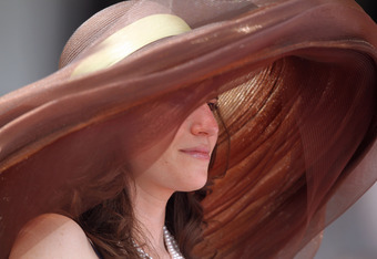LOUISVILLE, KY - MAY 07:  A fan looks on from the stands while she wears her derby hat during the 137th Kentucky Derby at Churchill Downs on May 7, 2011 in Louisville, Kentucky.  (Photo by Matthew Stockman/Getty Images)