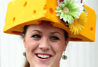 LOUISVILLE, KY - MAY 07:  A fan wears a cheese head hat in the paddock area during the 137th Kentucky Derby at Churchill Downs on May 7, 2011 in Louisville, Kentucky.  (Photo by Jamie Squire/Getty Images)