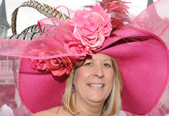 LOUISVILLE, KY - MAY 07:  Karen Van Zandt looks on while wearing her derby hat in the paddock area during the 137th Kentucky Derby at Churchill Downs on May 7, 2011 in Louisville, Kentucky.  (Photo by Harry How/Getty Images)