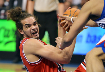 PHILADELPHIA, PA - MAY 04: Joakim Noah #13 of the Chicago Bulls looks to pass the ball during the game against the Philadelphia 76ers in Game Three of the Eastern Conference Quarterfinals in the 2012 NBA Playoffs at the Wells Fargo Center on May 4, 2012 i