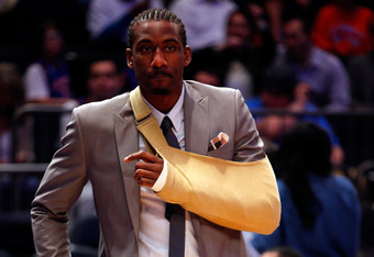 NEW YORK, NY - MAY 03:  Amare Stoudemire #1 of the New York Knicks wears a sling on his left arm due to a cut on his hand against the Miami Heat in Game Three of the Eastern Conference Quarterfinals in the 2012 NBA Playoffs on May 3, 2012 at Madison Squar