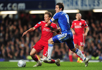 LONDON, UNITED KINGDOM - NOVEMBER 29: Frank Lampard of Chelsea challenges Lucas of Liverpool during the Carling Cup quarter final match between Chelsea and Liverpool at Stamford Bridge on November 29, 2011 in London, England.  (Photo by Jamie McDonald/Get