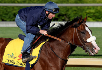 LOUISVILLE, KY - APRIL 27: Union Rags is riden by Peter Brette during the morning excercise session in preparation for the 138th Kentucky Derby at Churchill Downs on April 27, 2012 in Louisville, Kentucky.  (Photo by Matthew Stockman/Getty Images)