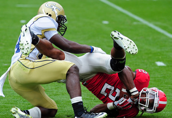 ATLANTA, GA - NOVEMBER 26: Brandon Boykin #2 of the Georgia Bulldogs is tackled by Jemea Thomas #14 of the Georgia Tech Yellow Jackets at Bobby Dodd Stadium on November 26, 2011 in Atlanta, Georgia. (Photo by Scott Cunningham/Getty Images)