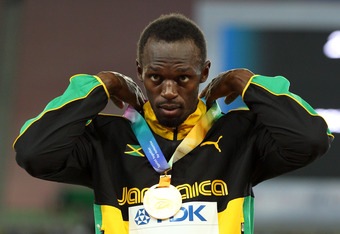 DAEGU, SOUTH KOREA - SEPTEMBER 04:  Usain Bolt of Jamaica poses with his gold medal during the medal ceremony for the men's 200 metres final during day nine of 13th IAAF World Athletics Championships at Daegu Stadium on September 4, 2011 in Daegu, South K