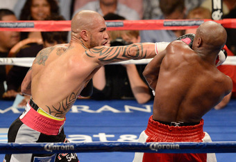 LAS VEGAS, NV - MAY 05:  (L-R) Miguel Cotto connects with a right to the face of Floyd Mayweather Jr. fight during their WBA super welterweight title fight at the MGM Grand Garden Arena on May 5, 2012 in Las Vegas, Nevada.  (Photo by Ethan Miller/Getty Im