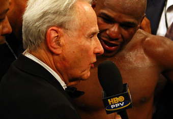 LAS VEGAS, NV - MAY 05:  HBO commentator Larry Merchant interviews Floyd Mayweather Jr. after Mayweather Jr. defeats Miguel Cotto by unanimous decision during their WBA super welterweight title fight at the MGM Grand Garden Arena on May 5, 2012 in Las Veg