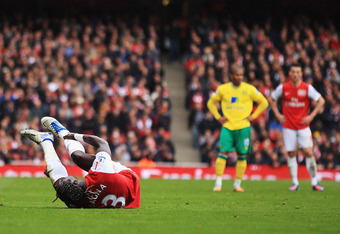LONDON, ENGLAND - MAY 05:  Bacary Sagna of Arsenal lies injured on the pitch during the Barclays Premier League match between Arsenal and Norwich City at the Emirates Stadium on May 5, 2012 in London, England.  (Photo by Bryn Lennon/Getty Images)