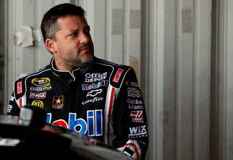 RICHMOND, VA - APRIL 27:  Tony Stewart, driver of the #14 Mobil 1/Office Depot Chevrolet, stands in the garage during practice for the NASCAR Sprint Cup Series Capital City 400 at Richmond International Raceway on April 27, 2012 in Richmond, Virginia.  (P