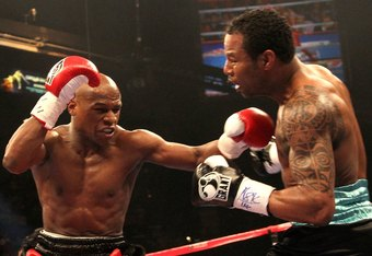 Floyd Mayweather (left) and Shane Mosley (right) duke it out in the ring. The win over Mosley was arguably the greatest of Mayweather's career.