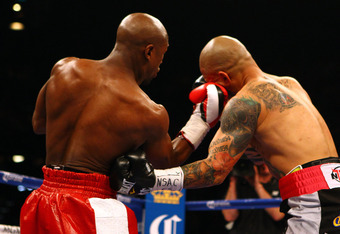 LAS VEGAS, NV - MAY 05:  (L-R) Floyd Mayweather Jr. throws a right to the face of Miguel Cotto during their WBA super welterweight title fight at the MGM Grand Garden Arena on May 5, 2012 in Las Vegas, Nevada.  (Photo by Al Bello/Getty Images)