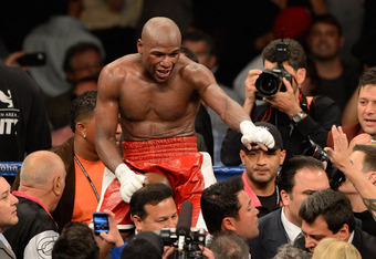 LAS VEGAS, NV - MAY 05:  Floyd Mayweather Jr. celebrates after defeating Miguel Cotto by unanimous decision during their WBA super welterweight title fight at the MGM Grand Garden Arena on May 5, 2012 in Las Vegas, Nevada.  (Photo by Ethan Miller/Getty Im