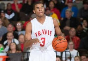 Aaron Harrison playing for Travis High School