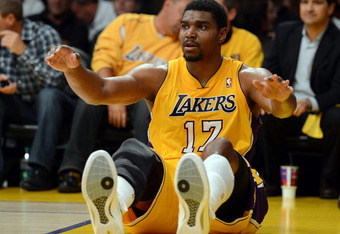 LOS ANGELES, CA - MAY 01:  Andrew Bynum #17 of the Los Angeles Lakers falls to the floor after his shot against the Denver Nuggets during Game Two of the Western Conference Quarterfinals in the 2012 NBA Playoffs at Staples Center on May 1, 2012 in Los Ang