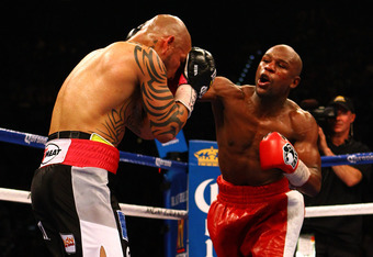 LAS VEGAS, NV - MAY 05:  (R-L) Floyd Mayweather Jr.throws a right to the face of Miguel Cotto during their WBA super welterweight title fight at the MGM Grand Garden Arena on May 5, 2012 in Las Vegas, Nevada.  (Photo by Al Bello/Getty Images)