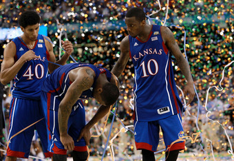 NEW ORLEANS, LA - APRIL 02:  Kevin Young #40, Thomas Robinson #0 and Tyshawn Taylor #10 of the Kansas Jayhawks react after losing to the Kentucky Wildcats 67-59 in the National Championship Game of the 2012 NCAA Division I Men's Basketball Tournament at t