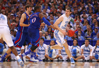 ST LOUIS, MO - MARCH 25:  Tyler Zeller #44 of the North Carolina Tar Heels looks to pass against Thomas Robinson #0 of the Kansas Jayhawks during the 2012 NCAA Men's Basketball Midwest Regional Final at Edward Jones Dome on March 25, 2012 in St Louis, Mis