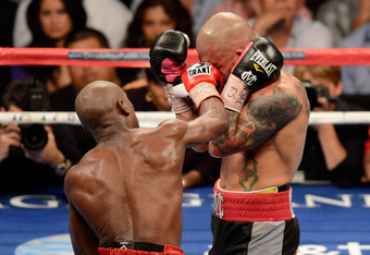 LAS VEGAS, NV - MAY 05:  (L-R) Floyd Mayweather Jr. throws a right to the head of Miguel Cotto during their WBA super welterweight title fight at the MGM Grand Garden Arena on May 5, 2012 in Las Vegas, Nevada.  (Photo by Ethan Miller/Getty Images)